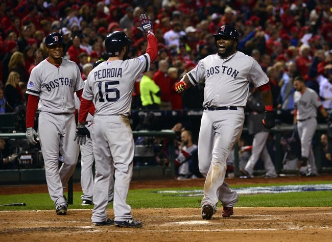 Oct 27, 2013; St. Louis, MO, USA; Boston Red Sox first baseman David Ortiz (right) celebrates with second baseman Dustin Pedroia (15) after scoring on a three-run home run by left fielder Jonny Gomes (not pictured) in the sixth inning against the St. Louis Cardinals during game four of the MLB baseball World Series at Busch Stadium. Mandatory Credit: Scott Rovak-USA TODAY Sports