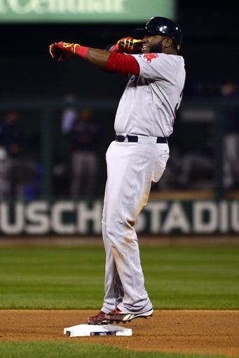 Oct 27, 2013; St. Louis, MO, USA; Boston Red Sox first baseman David Ortiz reacts after a double against the St. Louis Cardinals during game four of the MLB baseball World Series at Busch Stadium. Mandatory Credit: Scott Rovak-USA TODAY Sports