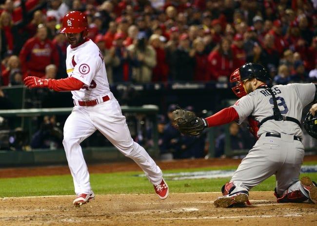 Oct 27, 2013; St. Louis, MO, USA; St. Louis Cardinals pinch hitter Shane Robinson (43) scores a run past Boston Red Sox catcher David Ross (3) during game four of the MLB baseball World Series at Busch Stadium. Mandatory Credit: Scott Rovak-USA TODAY Sports
