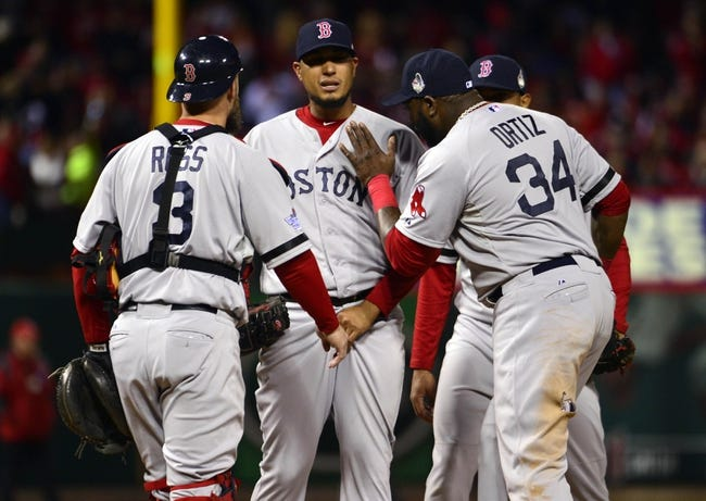 Oct 27, 2013; St. Louis, MO, USA; Boston Red Sox pitcher Felix Doubront (middle) gets a pat on the chest from first baseman David Ortiz (34) during game four of the MLB baseball World Series against the St. Louis Cardinals at Busch Stadium. Mandatory Credit: Scott Rovak-USA TODAY Sports