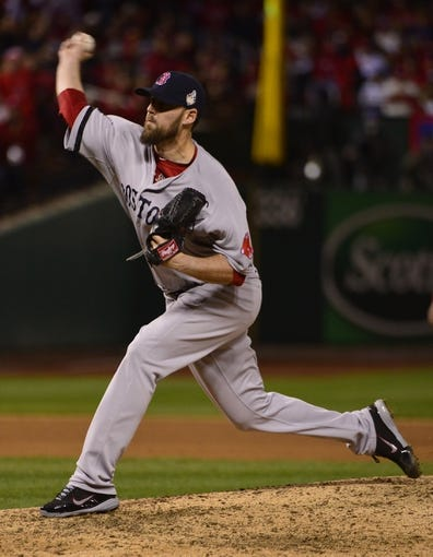 Oct 27, 2013; St. Louis, MO, USA; Boston Red Sox pitcher John Lackey throws a pitch against the St. Louis Cardinals in the 8th inning during game four of the MLB baseball World Series at Busch Stadium. Mandatory Credit: Scott Rovak-USA TODAY Sports