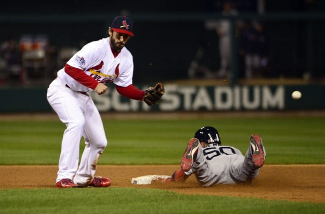 Oct 27, 2013; St. Louis, MO, USA; Boston Red Sox pinch runner Quintin Berry (50) steals second base as St. Louis Cardinals second baseman Matt Carpenter is unable to field the throw in the 8th inning during game four of the MLB baseball World Series at Busch Stadium. Mandatory Credit: Scott Rovak-USA TODAY Sports
