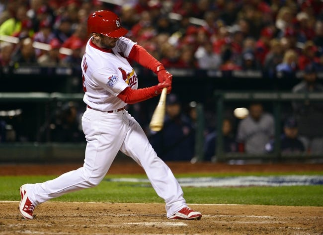 Oct 27, 2013; St. Louis, MO, USA; St. Louis Cardinals pinch hitter Shane Robinson hits a double against the Boston Red Sox during game four of the MLB baseball World Series at Busch Stadium. Mandatory Credit: Scott Rovak-USA TODAY Sports