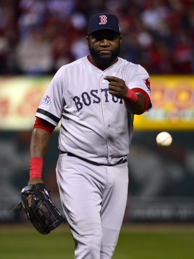 Oct 27, 2013; St. Louis, MO, USA; Boston Red Sox first baseman David Ortiz tosses the ball in the third inning during game four of the MLB baseball World Series against the St. Louis Cardinals at Busch Stadium. Mandatory Credit: Scott Rovak-USA TODAY Sports