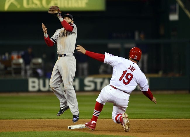 Oct 27, 2013; St. Louis, MO, USA; Boston Red Sox second baseman Dustin Pedroia (left) forces out St. Louis Cardinals center fielder Jon Jay (19) on a fielder's choice during game four of the MLB baseball World Series at Busch Stadium. Mandatory Credit: Scott Rovak-USA TODAY Sports
