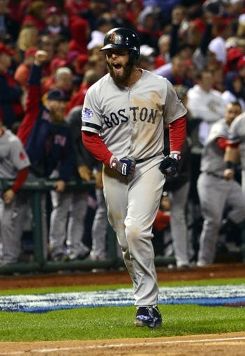 Oct 27, 2013; St. Louis, MO, USA; Boston Red Sox second baseman Dustin Pedroia reacts after a three-run home run by left fielder Jonny Gomes (not pictured) in the sixth inning against the St. Louis Cardinals during game four of the MLB baseball World Series at Busch Stadium. Mandatory Credit: Scott Rovak-USA TODAY Sports