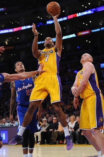 Oct 29, 2013; Los Angeles, CA, USA;   Los Angeles Lakers shooting guard Xavier Henry (7) scores in front of Los Angeles Clippers small forward Matt Barnes (22) in the second half of the game at the Staples Center. Lakers won 116-103. Mandatory Credit: Jayne Kamin-Oncea-USA TODAY Sports