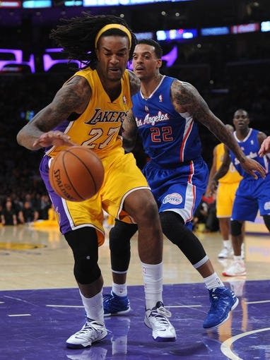 Oct 29, 2013; Los Angeles, CA, USA;   Los Angeles Clippers small forward Matt Barnes (22) guards Los Angeles Lakers center Jordan Hill (27) in the second half of the game at the Staples Center. Lakers won 116-103. Mandatory Credit: Jayne Kamin-Oncea-USA TODAY Sports