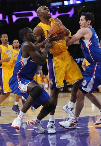 Oct 29, 2013; Los Angeles, CA, USA;  Los Angeles Clippers shooting guard J.J. Redick (4) and Los Angeles Clippers point guard Darren Collison (2) guard Los Angeles Lakers shooting guard Jodie Meeks (20) in the second half of the game at the Staples Center. Lakers won 116-103. Mandatory Credit: Jayne Kamin-Oncea-USA TODAY Sports