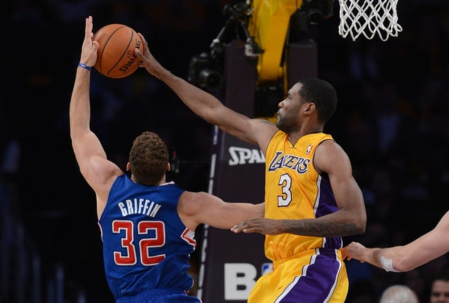 Oct 29, 2013; Los Angeles, CA, USA;  Los Angeles Lakers small forward Shawne Williams (3) blocks a shot by Los Angeles Clippers power forward Blake Griffin (32) in the second half of the game at Staples Center. Lakers won 116-103. Mandatory Credit: Jayne Kamin-Oncea-USA TODAY Sports