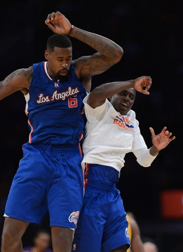 Oct 29, 2013; Los Angeles, CA, USA;  Los Angeles Clippers center DeAndre Jordan (6) and Los Angeles Clippers point guard Darren Collison (2) jump in the air in the second half of the game against the Los Angeles Lakers at Staples Center. Lakers won 116-103. Mandatory Credit: Jayne Kamin-Oncea-USA TODAY Sports