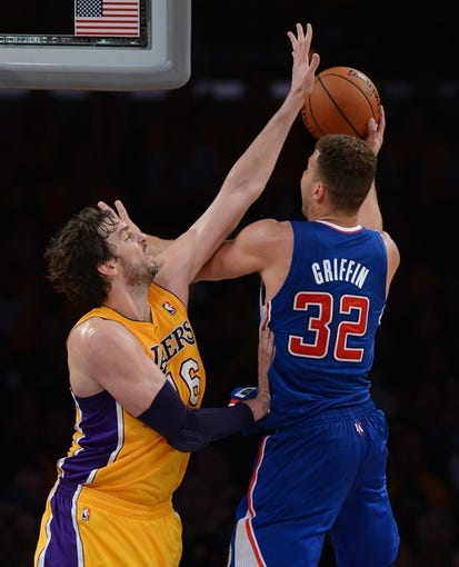 Oct 29, 2013; Los Angeles, CA, USA;  Los Angeles Lakers power forward Pau Gasol (16) guards Los Angeles Clippers power forward Blake Griffin (32) in the second half of the game at Staples Center. Lakers won 116-103. Mandatory Credit: Jayne Kamin-Oncea-USA TODAY Sports