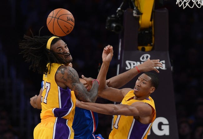 Oct 29, 2013; Los Angeles, CA, USA;  Los Angeles Lakers center Jordan Hill (27) and Los Angeles Lakers shooting guard Wesley Johnson (11) go for a rebound in the second half of the game against the Los Angeles Clippers at Staples Center. Lakers won 116-103. Mandatory Credit: Jayne Kamin-Oncea-USA TODAY Sports