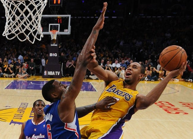 Oct 29, 2013; Los Angeles, CA, USA;   Los Angeles Lakers shooting guard Xavier Henry (7) makes a basket past Los Angeles Clippers center DeAndre Jordan (6) during the game at the Staples Center. Lakers won 116-103. Mandatory Credit: Jayne Kamin-Oncea-USA TODAY Sports