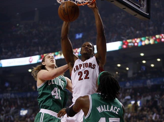 Oct 30, 2013; Toronto, Ontario, CAN; Toronto Raptors forward Rudy Gay (22) dunks in between Boston Celtics forward Kelly Olynyk (41) and forward Gerald Wallace (45) during the first half at the Air Canada Centre. Mandatory Credit: John E. Sokolowski-USA TODAY Sports