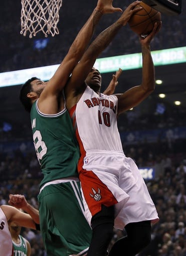 Oct 30, 2013; Toronto, Ontario, CAN; Boston Celtics center Vitor Faverani (38) defends against Toronto Raptors guard DeMar DeRozan (10) during the first half at the Air Canada Centre. Mandatory Credit: John E. Sokolowski-USA TODAY Sports