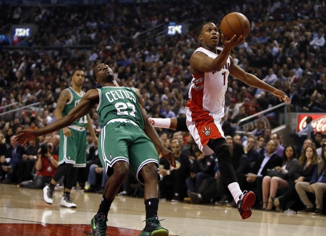 Oct 30, 2013; Toronto, Ontario, CAN; Toronto Raptors guard Kyle Lowry (7) drives to the net past Boston Celtics guard Jordan Crawford (27) during the first half at the Air Canada Centre. Mandatory Credit: John E. Sokolowski-USA TODAY Sports
