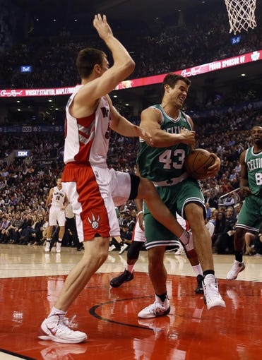 Oct 30, 2013; Toronto, Ontario, CAN; Boston Celtics forward Kris Humphries (43) battles with Toronto Raptors forward Tyler Hansbrough (50) for a rebound during the first half at the Air Canada Centre. Mandatory Credit: John E. Sokolowski-USA TODAY Sports
