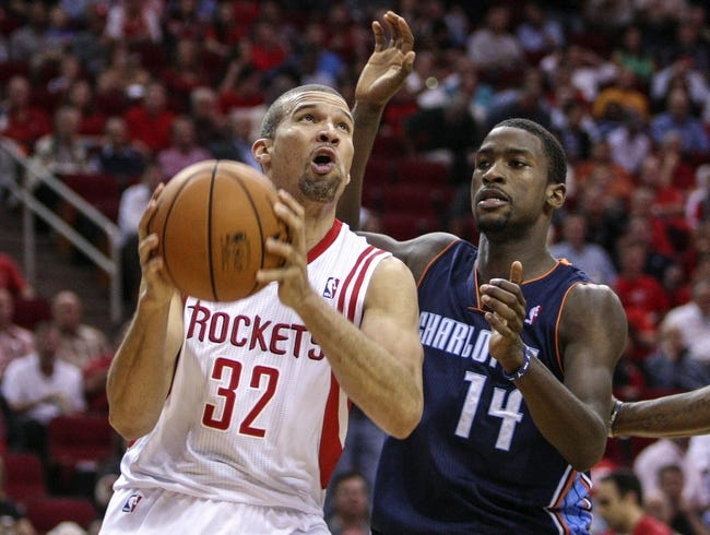 Oct 30, 2013; Houston, TX, USA; Houston Rockets shooting guard Francisco Garcia (32) drives to the basket during the second quarter as Charlotte Bobcats small forward Michael Kidd-Gilchrist (14) defends at Toyota Center. Mandatory Credit: Troy Taormina-USA TODAY Sports
