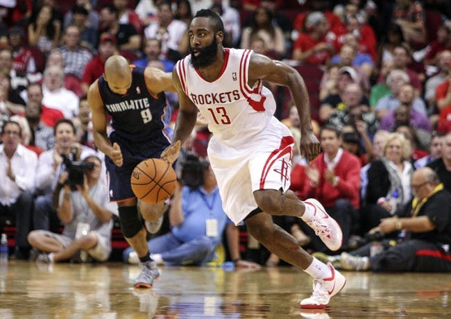 Oct 30, 2013; Houston, TX, USA; Houston Rockets shooting guard James Harden (13) dribbles on a fast break during the second quarter against the Charlotte Bobcats at Toyota Center. Mandatory Credit: Troy Taormina-USA TODAY Sports