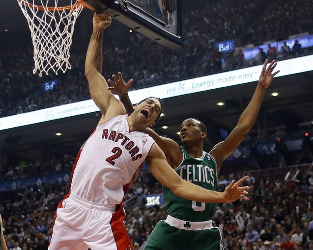 Oct 30, 2013; Toronto, Ontario, CAN; Toronto Raptors forward Landry Fields (2) reacts as he is contacted by Boston Celtics guard Avery Bradley (0) at the Air Canada Centre. Toronto defeated Boston 93-87. Mandatory Credit: John E. Sokolowski-USA TODAY Sports