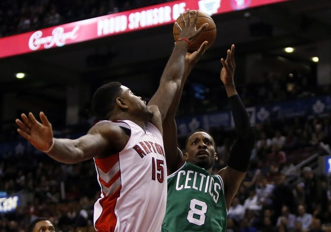 Oct 30, 2013; Toronto, Ontario, CAN; Toronto Raptors forward-center Amir Johnson (15) defends against Boston Celtics forward Jeff Green (8) at the Air Canada Centre. Toronto defeated Boston 93-87. Mandatory Credit: John E. Sokolowski-USA TODAY Sports