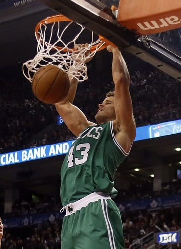 Oct 30, 2013; Toronto, Ontario, CAN; Boston Celtics forward Kris Humphries (43) dunks against the Toronto Raptors at the Air Canada Centre. Toronto defeated Boston 93-87. Mandatory Credit: John E. Sokolowski-USA TODAY Sports