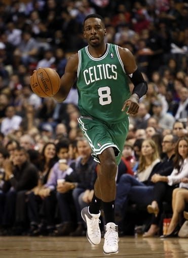Oct 30, 2013; Toronto, Ontario, CAN; Boston Celtics forward Jeff Green (8) carries the ball against the Toronto Raptors at the Air Canada Centre. Toronto defeated Boston 93-87. Mandatory Credit: John E. Sokolowski-USA TODAY Sports
