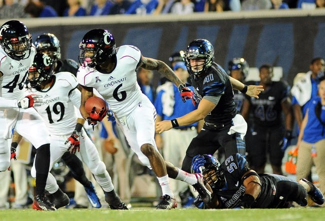 Oct 30, 2013; Memphis, TN, USA; Cincinnati Bearcats wide receiver Anthony McClung (6) carries the ball against Memphis Tigers during the second quarter at Liberty Bowl Memorial. Mandatory Credit: Justin Ford-USA TODAY Sports
