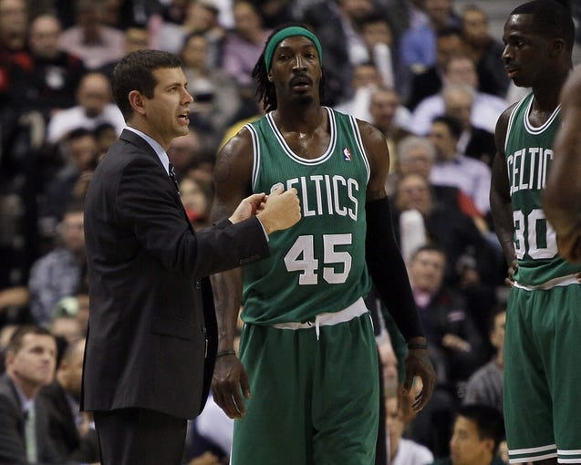 Oct 30, 2013; Toronto, Ontario, CAN; Boston Celtics head coach Brad Stevens (left) talks to forward Gerald Wallace (45) and forward Brandon Bass (30) during a break against the Toronto Raptors at the Air Canada Centre. Toronto defeated Boston 93-87. Mandatory Credit: John E. Sokolowski-USA TODAY Sports