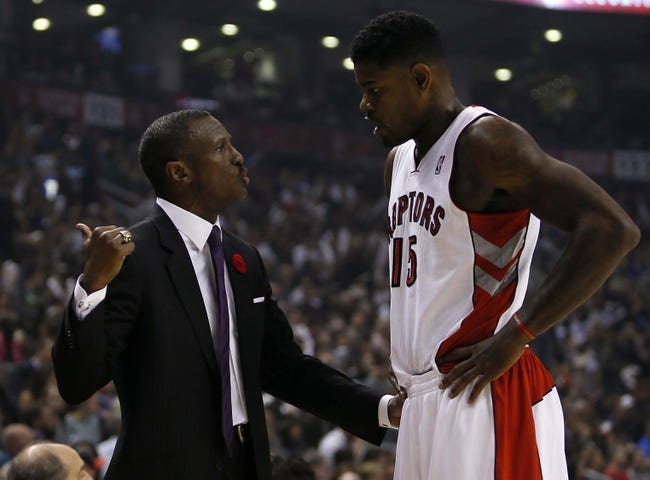 Oct 30, 2013; Toronto, Ontario, CAN; Toronto Raptors head coach Dwane Casey talks to Toronto Raptors forward-center Amir Johnson (15) during a break against the Boston Celtics at the Air Canada Centre. Toronto defeated Boston 93-87. Mandatory Credit: John E. Sokolowski-USA TODAY Sports