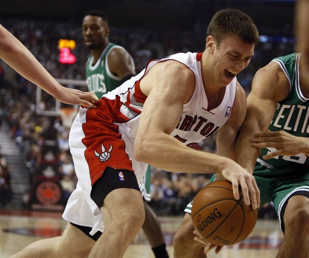 Oct 30, 2013; Toronto, Ontario, CAN; Toronto Raptors forward Tyler Hansbrough (50) dribbles the ball against the Boston Celtics at the Air Canada Centre. Toronto defeated Boston 93-87. Mandatory Credit: John E. Sokolowski-USA TODAY Sports