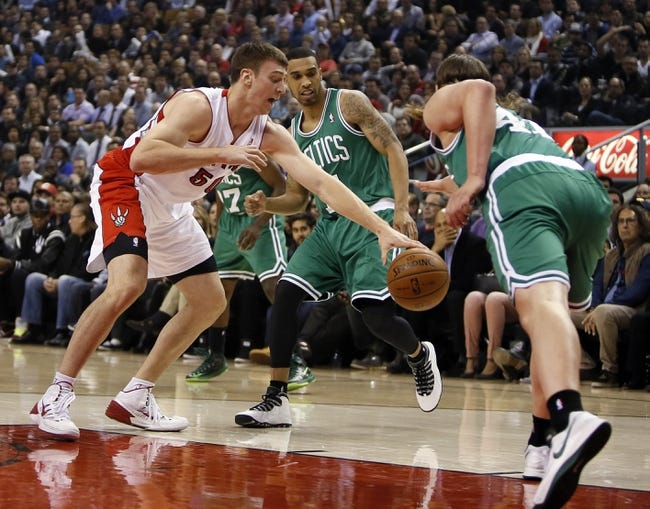 Oct 30, 2013; Toronto, Ontario, CAN; Toronto Raptors forward Tyler Hansbrough (50) tries to take the ball away from Boston Celtics forward Kelly Olynyk (41) as guard Courtney Lee (11) looks on at the Air Canada Centre. Toronto defeated Boston 93-87. Mandatory Credit: John E. Sokolowski-USA TODAY Sports