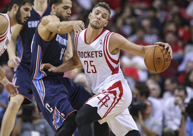 Oct 30, 2013; Houston, TX, USA; Houston Rockets small forward Chandler Parsons (25) attempts to drive the ball around Charlotte Bobcats shooting guard Jeffery Taylor (44) during the third quarter at Toyota Center. The Rockets defeated the Bobcats 96-83. Mandatory Credit: Troy Taormina-USA TODAY Sports