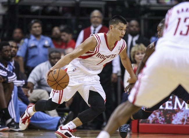 Oct 30, 2013; Houston, TX, USA; Houston Rockets point guard Jeremy Lin (7) drives the ball during the fourth quarter against the Charlotte Bobcats at Toyota Center. The Rockets defeated the Bobcats 96-83. Mandatory Credit: Troy Taormina-USA TODAY Sports