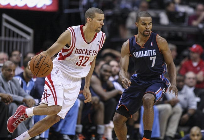 Oct 30, 2013; Houston, TX, USA; Houston Rockets shooting guard Francisco Garcia (32) attempts to drive the ball around Charlotte Bobcats point guard Ramon Sessions (7) during the third quarter at Toyota Center. The Rockets defeated the Bobcats 96-83. Mandatory Credit: Troy Taormina-USA TODAY Sports