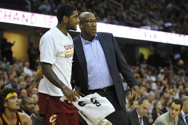 Oct 30, 2013; Cleveland, OH, USA; Cleveland Cavaliers point guard Kyrie Irving (left) and head coach Mike Brown talk in the third quarter against the Brooklyn Nets at Quicken Loans Arena. Mandatory Credit: David Richard-USA TODAY Sports