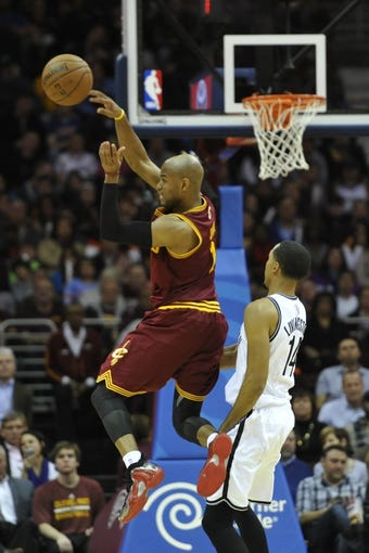 Oct 30, 2013; Cleveland, OH, USA; Cleveland Cavaliers point guard Jarrett Jack (1) makes a pass against Brooklyn Nets point guard Shaun Livingston (14) in the fourth quarter at Quicken Loans Arena. Mandatory Credit: David Richard-USA TODAY Sports