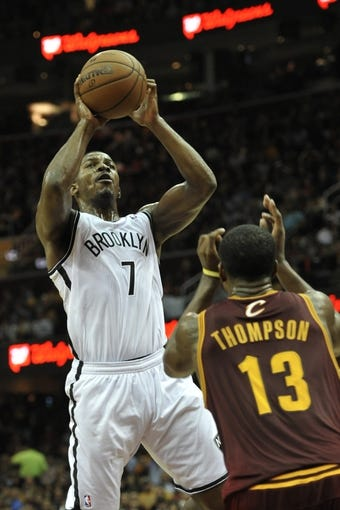 Oct 30, 2013; Cleveland, OH, USA; Brooklyn Nets shooting guard Joe Johnson (7) shoots over Cleveland Cavaliers power forward Tristan Thompson (13) in the third quarter at Quicken Loans Arena. Mandatory Credit: David Richard-USA TODAY Sports