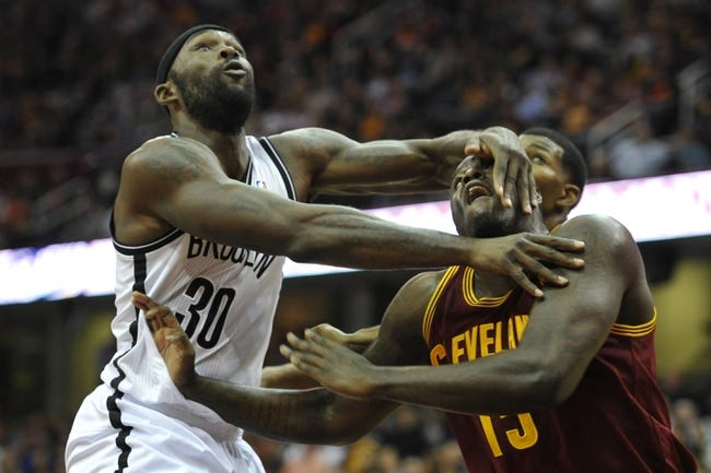 Oct 30, 2013; Cleveland, OH, USA; Brooklyn Nets power forward Reggie Evans (30) battles for a rebound against Cleveland Cavaliers small forward Anthony Bennett (15) in the third quarter at Quicken Loans Arena. Mandatory Credit: David Richard-USA TODAY Sports