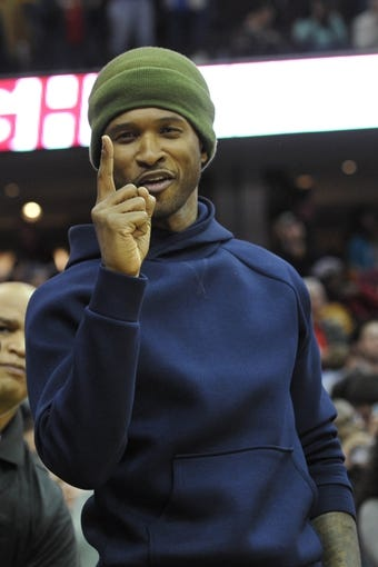 Oct 30, 2013; Cleveland, OH, USA; Music entertainer Usher cheers in the fourth quarter of a game between the Cleveland Cavaliers and the Brooklyn Nets at Quicken Loans Arena. Mandatory Credit: David Richard-USA TODAY Sports
