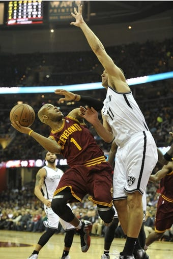Oct 30, 2013; Cleveland, OH, USA; Cleveland Cavaliers point guard Jarrett Jack (1) shoots against Brooklyn Nets center Brook Lopez (11)  in the first quarter at Quicken Loans Arena. Mandatory Credit: David Richard-USA TODAY Sports