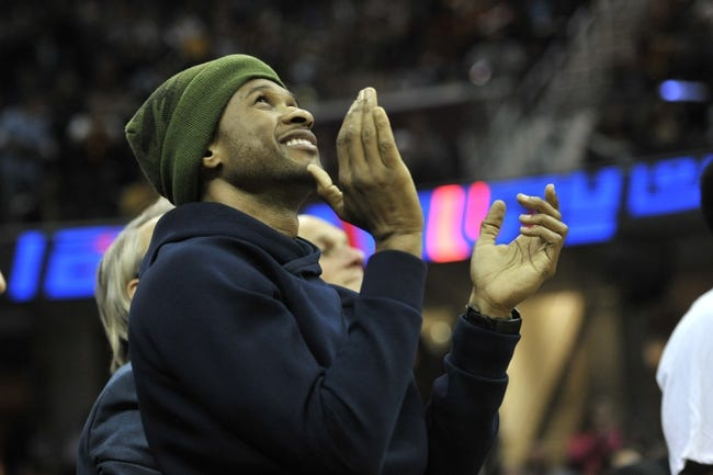 Oct 30, 2013; Cleveland, OH, USA; Music entertainer Usher cheers in the first quarter of a game between the Cleveland Cavaliers and the Brooklyn Nets at Quicken Loans Arena. Mandatory Credit: David Richard-USA TODAY Sports