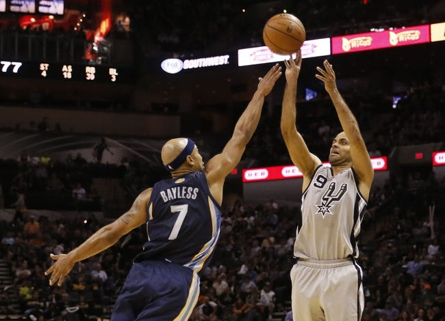 Oct 30, 2013; San Antonio, TX, USA; San Antonio Spurs guard Tony Parker (9) shoots against Memphis Grizzlies guard Jerryd Bayless (7) during the second half at AT&T Center. The Spurs won 101-94. Mandatory Credit: Soobum Im-USA TODAY Sports