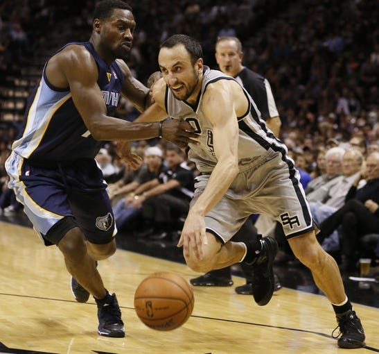 Oct 30, 2013; San Antonio, TX, USA; San Antonio Spurs guard Manu Ginobili (right) drives to the basket while guarded by Memphis Grizzlies guard Tony Allen (left) during the second half at AT&T Center. The Spurs won 101-94. Mandatory Credit: Soobum Im-USA TODAY Sports