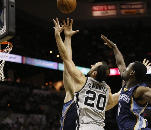 Oct 30, 2013; San Antonio, TX, USA; San Antonio Spurs guard Manu Ginobili (20) drives to the basket as Memphis Grizzlies center Marc Gasol (left) and guard Tony Allen (right) defend during the second half at AT&T Center. The Spurs won 101-94. Mandatory Credit: Soobum Im-USA TODAY Sports