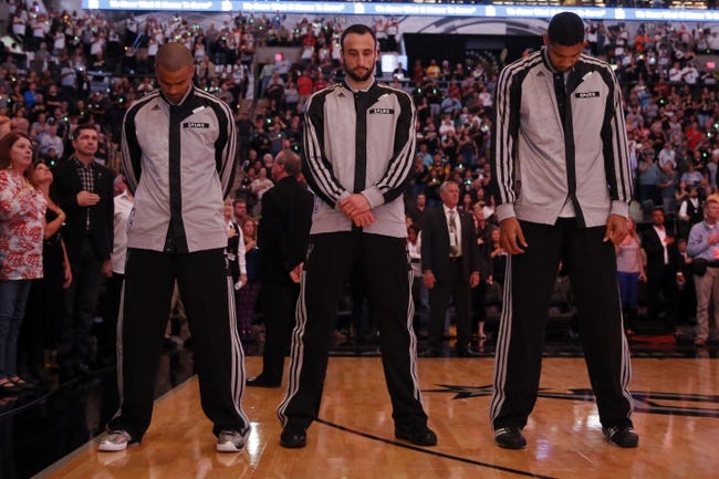 Oct 30, 2013; San Antonio, TX, USA; San Antonio Spurs players (from left) Tony Parker, and Manu Ginobili, and Tim Duncan during the national anthem before the game against the Memphis Grizzlies at AT&T Center. Mandatory Credit: Soobum Im-USA TODAY Sports