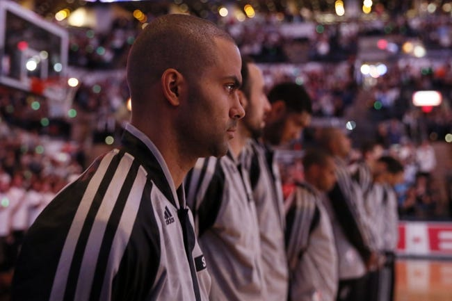 Oct 30, 2013; San Antonio, TX, USA; San Antonio Spurs guard Tony Parker (9) during the national anthem before the game against the Memphis Grizzlies at AT&T Center. Mandatory Credit: Soobum Im-USA TODAY Sports