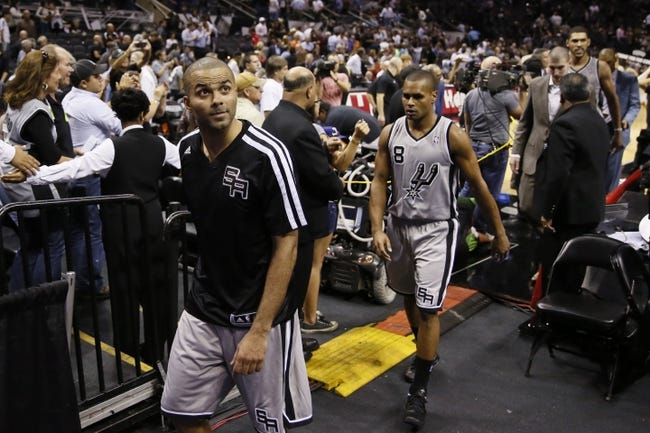 Oct 30, 2013; San Antonio, TX, USA; San Antonio Spurs guard Tony Parker (far left) walks off the court following their win over the Memphis Grizzlies at AT&T Center. The Spurs won 101-94. Mandatory Credit: Soobum Im-USA TODAY Sports
