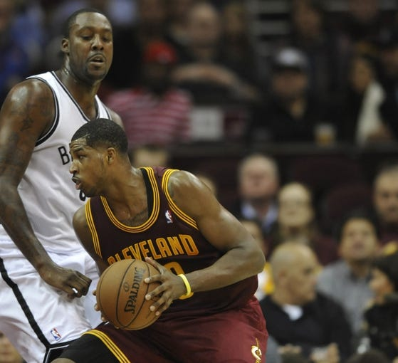 Oct 30, 2013; Cleveland, OH, USA; Cleveland Cavaliers power forward Tristan Thompson (right) works against Brooklyn Nets center Andray Blatche (0) in the third quarter at Quicken Loans Arena. Mandatory Credit: David Richard-USA TODAY Sports